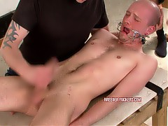 Pinned down naked, fitted with mouth gag, made to deep throat cock, dick manipulated till he's hard and wanked off so he cums in his own face, arse filled with buttplug and flogged, mercilessly fucked and made to rim a man's anus, breath control, men cum on his arsehole and dick.