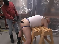 His chubby bear ass is spanked and screwed while he's helplessly tied up